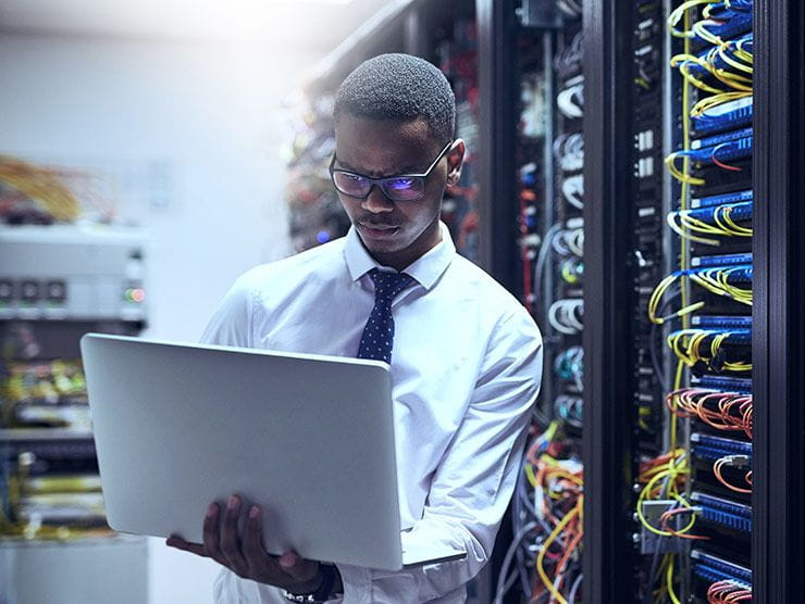 employee on laptop in data warehouse
