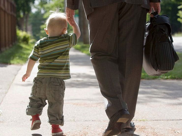 Little boy with Autism walking outside with dad