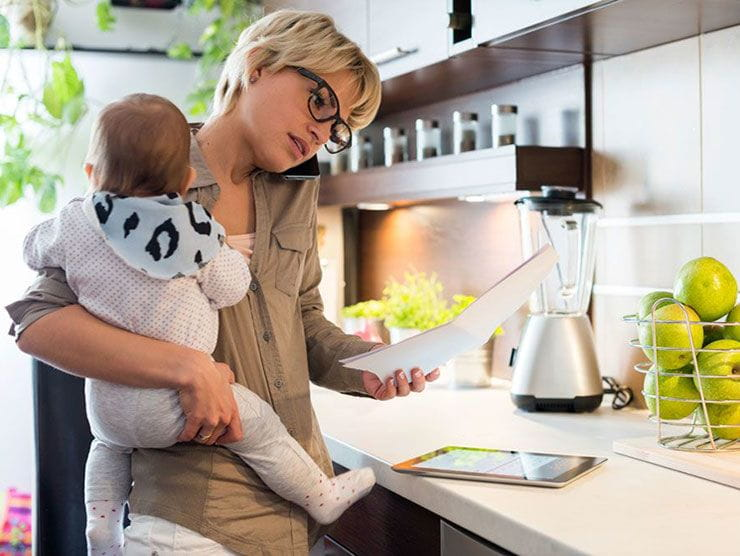 Mom working at home while caring for baby