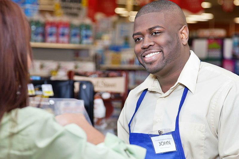 Frontline retail worker helping a customer