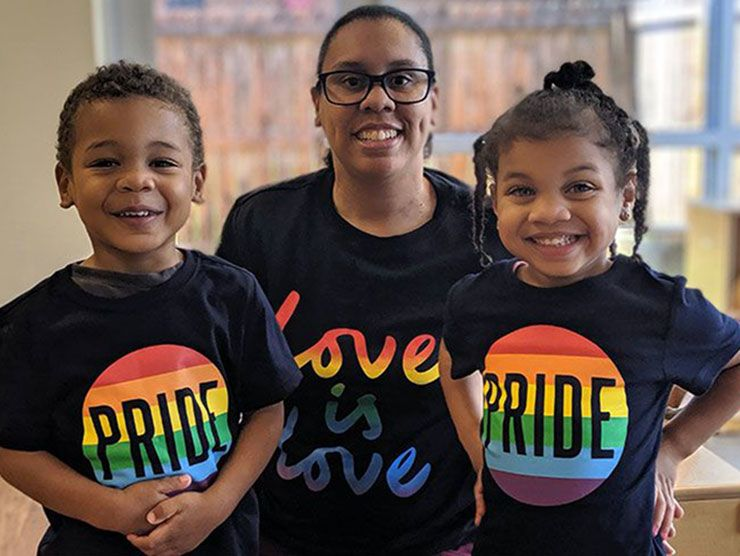 Center Director and her two children wearing pride shirts