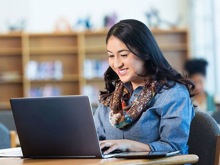 Young female professional using education benefits