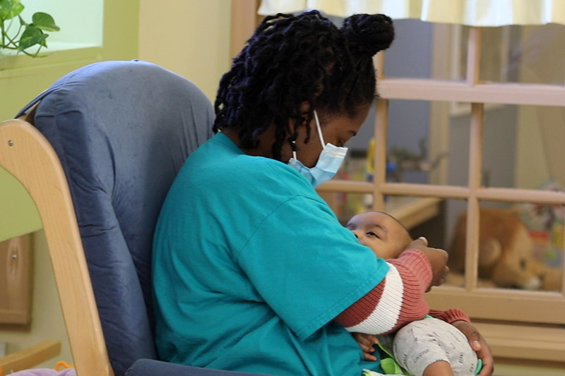 Child care teacher caring for a doctor's infant during COVID-19