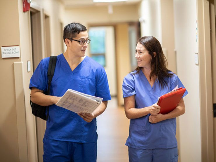 Male and female nurses discussing their certificate program
