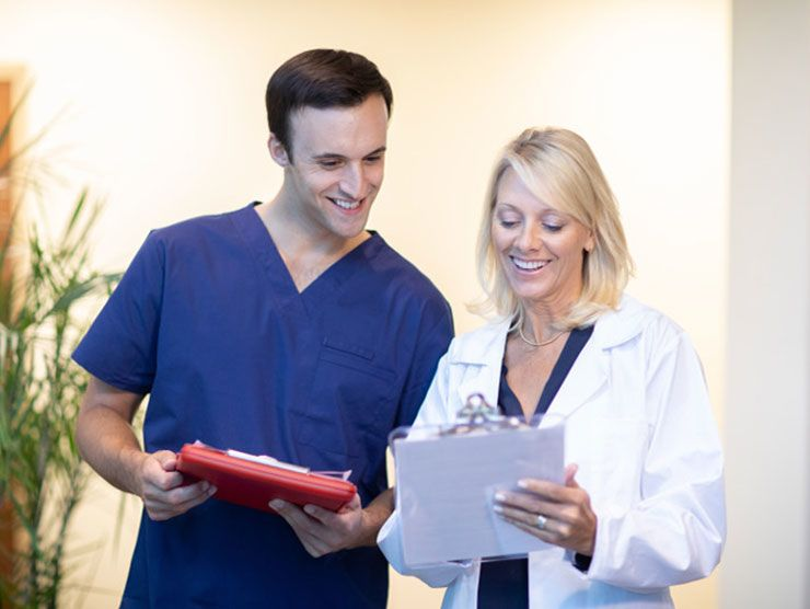 Nurse and doctor discussing a patient's chart