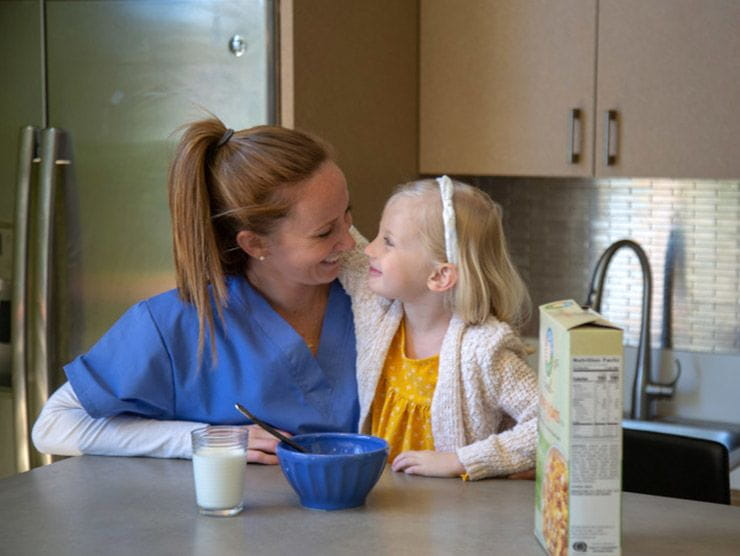 Healthcare employee at home with her daughter