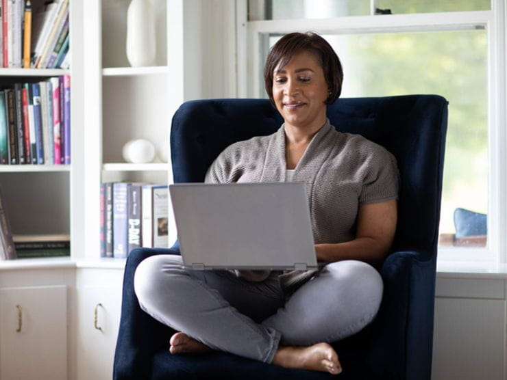 Employee studying for a flat-rate tuition program from home