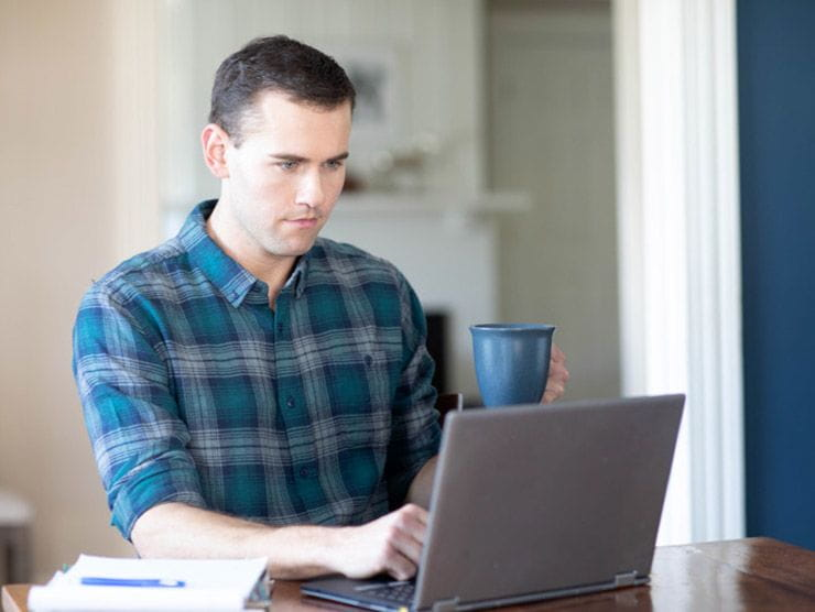 Employee studying for a degree from home