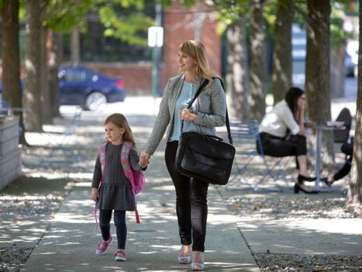 Working mom walking her young daughter to school