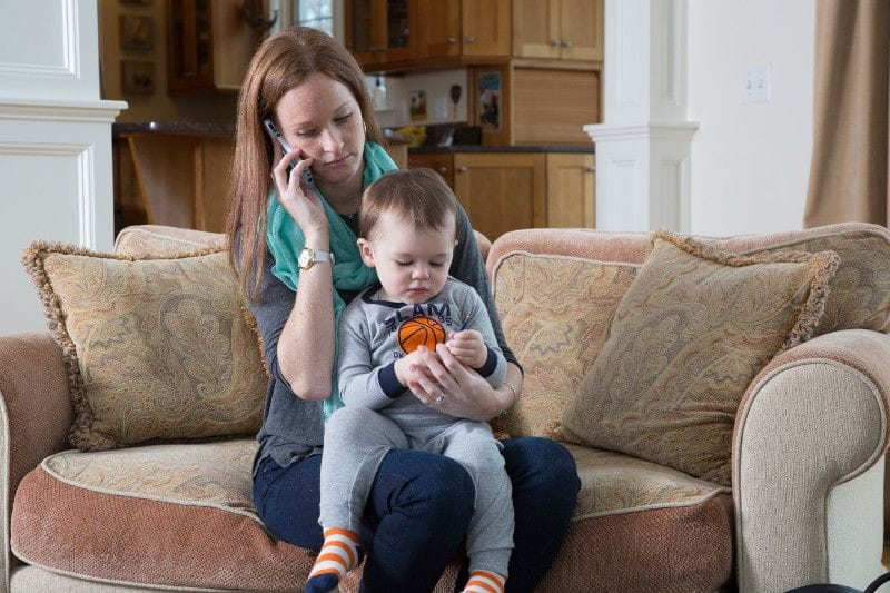 woman with baby calling to get back-up care