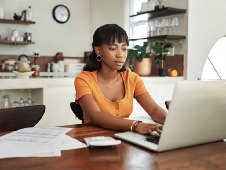 Woman of color using her education assistance benefit after work