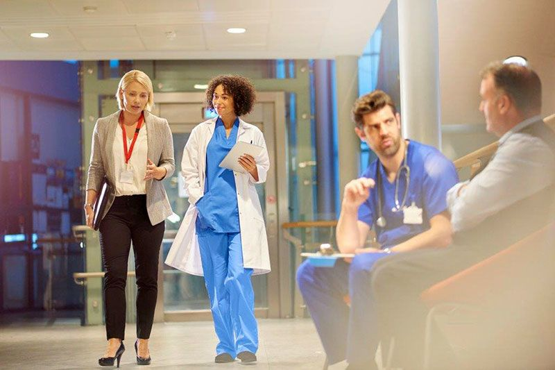 Healthcare professionals conversing in a hospital