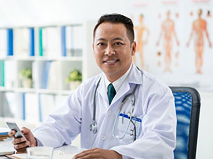 Healthcare professional sitting in his office