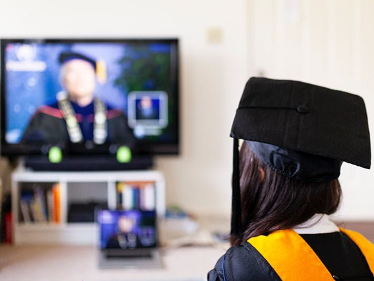 Adult learner attending her higher education merger virtual graduation