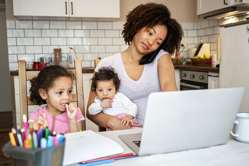 Mom trying to work from home while caring for her two kids