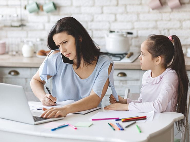 Mom trying to work at home while her daughter needs school help