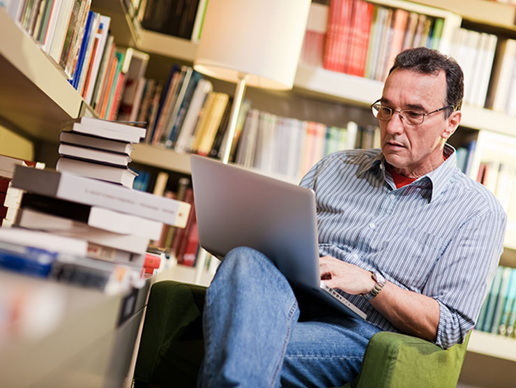 Middle-aged man studying for a degree or certification