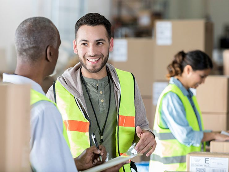 Warehouse employee using new skills from education assistance