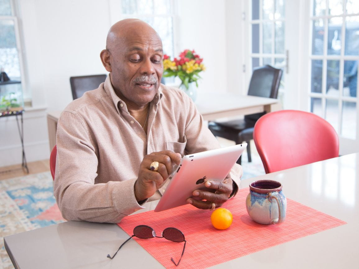 elderly man keeping his skills sharp by using a tablet computer
