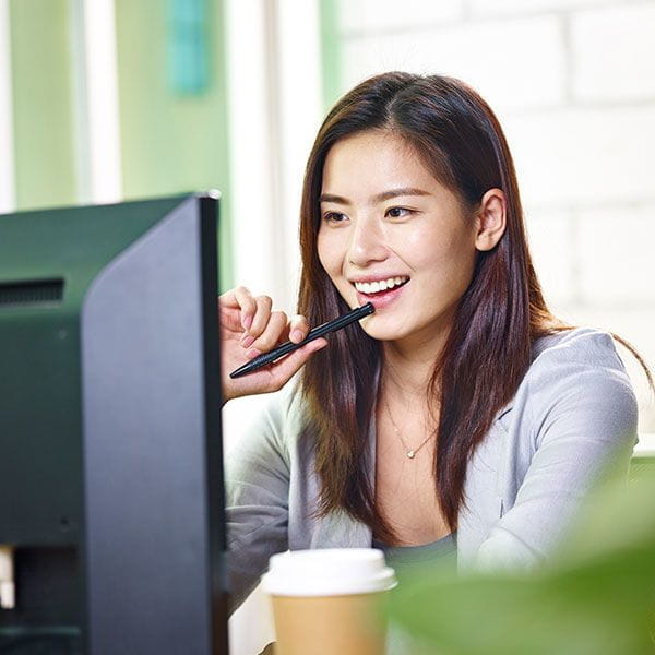 Young woman looking at a computer monitor