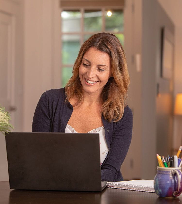 Woman using her laptop to contact Bright Horizons