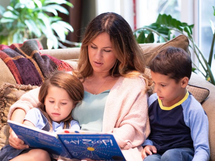 mother reading to her kids and teaching them about race