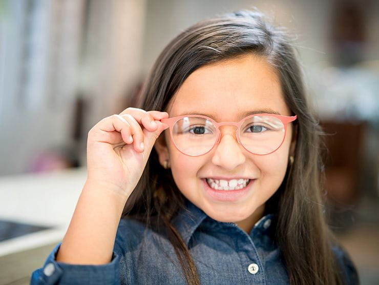 girl smiling with glasses on