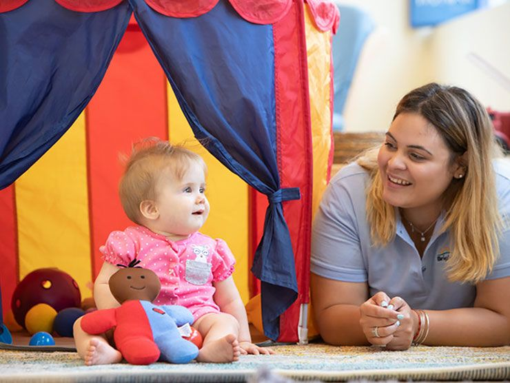 Infant and teacher in a developmentally appropriate child care classroom