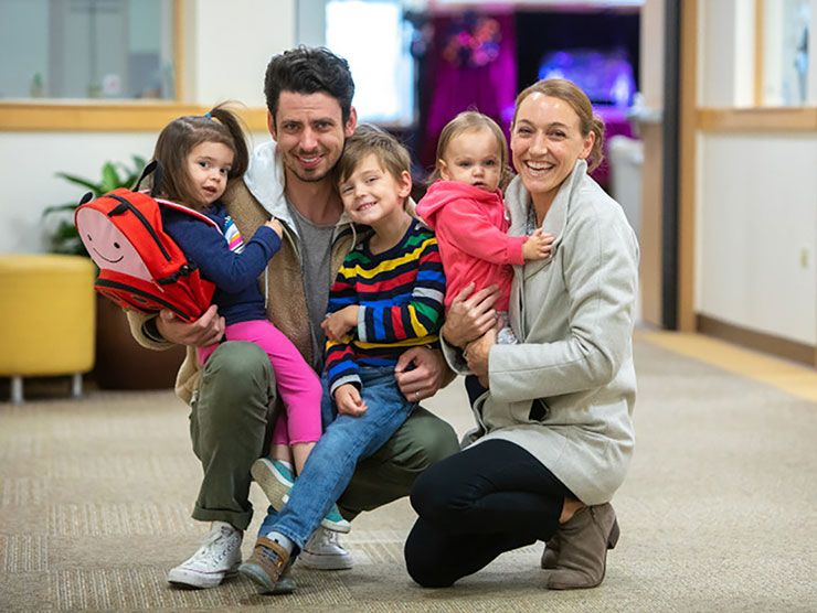 Family of five at a child care center
