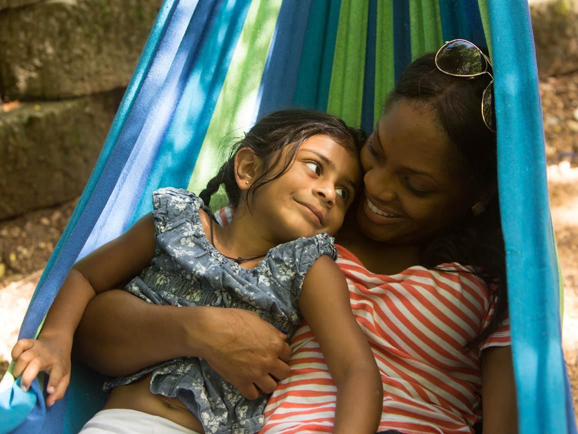 A mother and daughter in a hammock