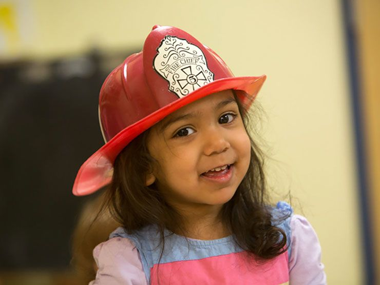 Preschool girl wearing a firefighter's hat