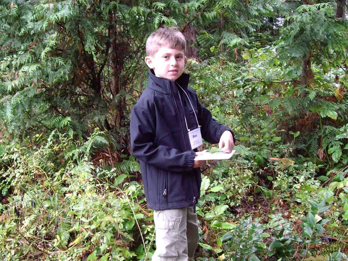 Elementary school-aged boy walking a nature trail