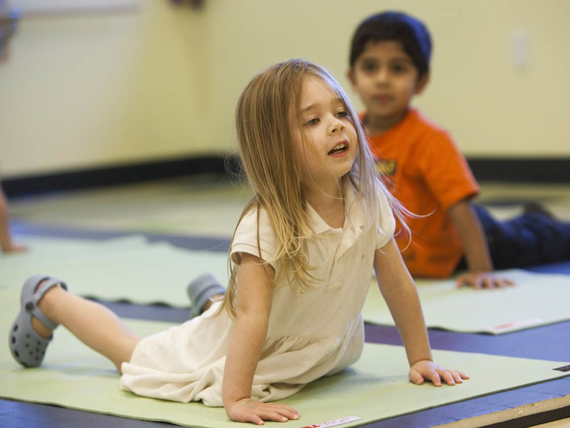 Preschool children doing yoga