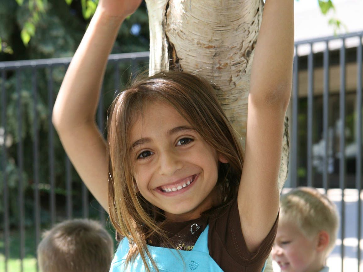 A Child Hugging a Tree