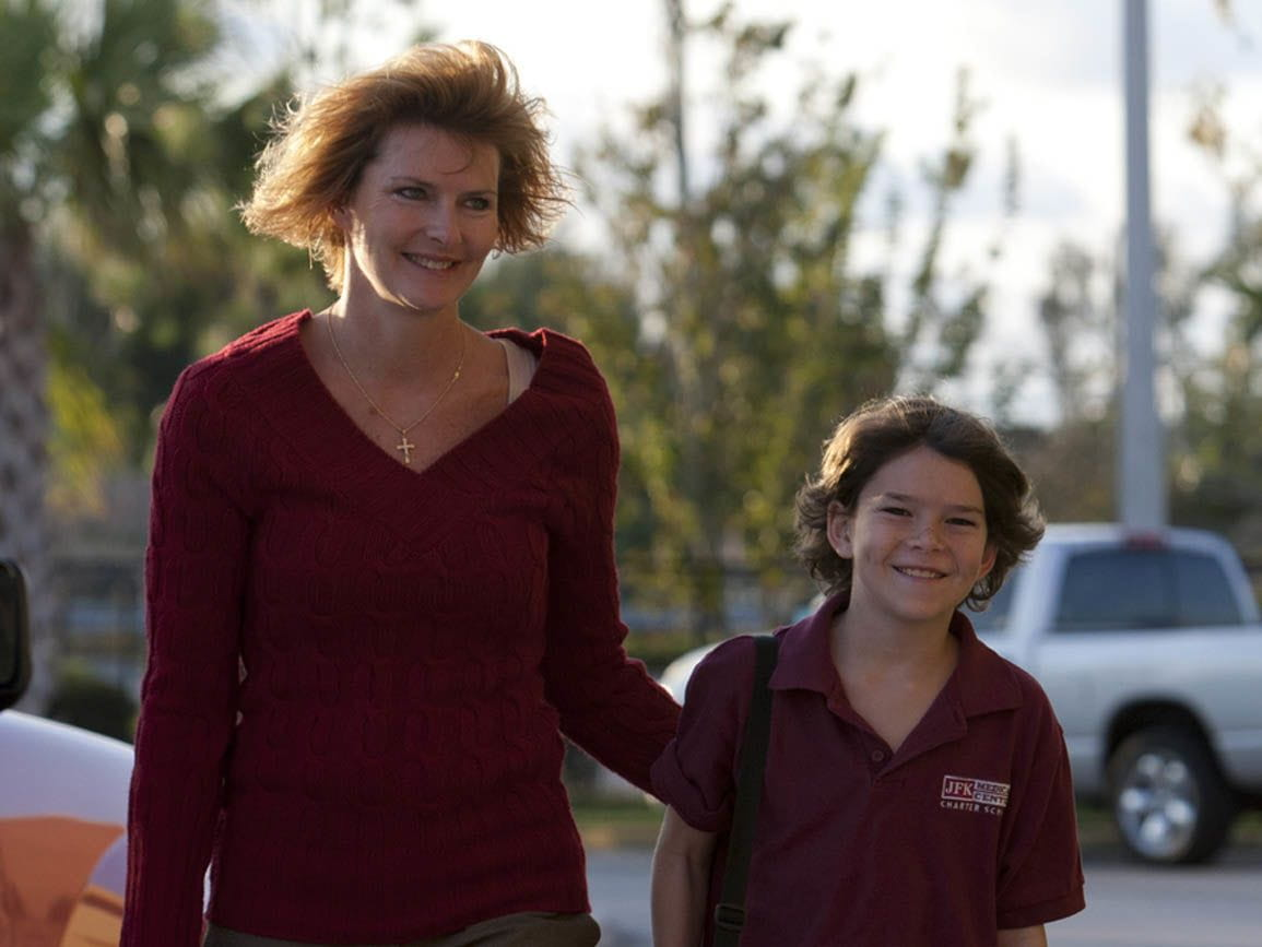 Mom and tween girl walking to school