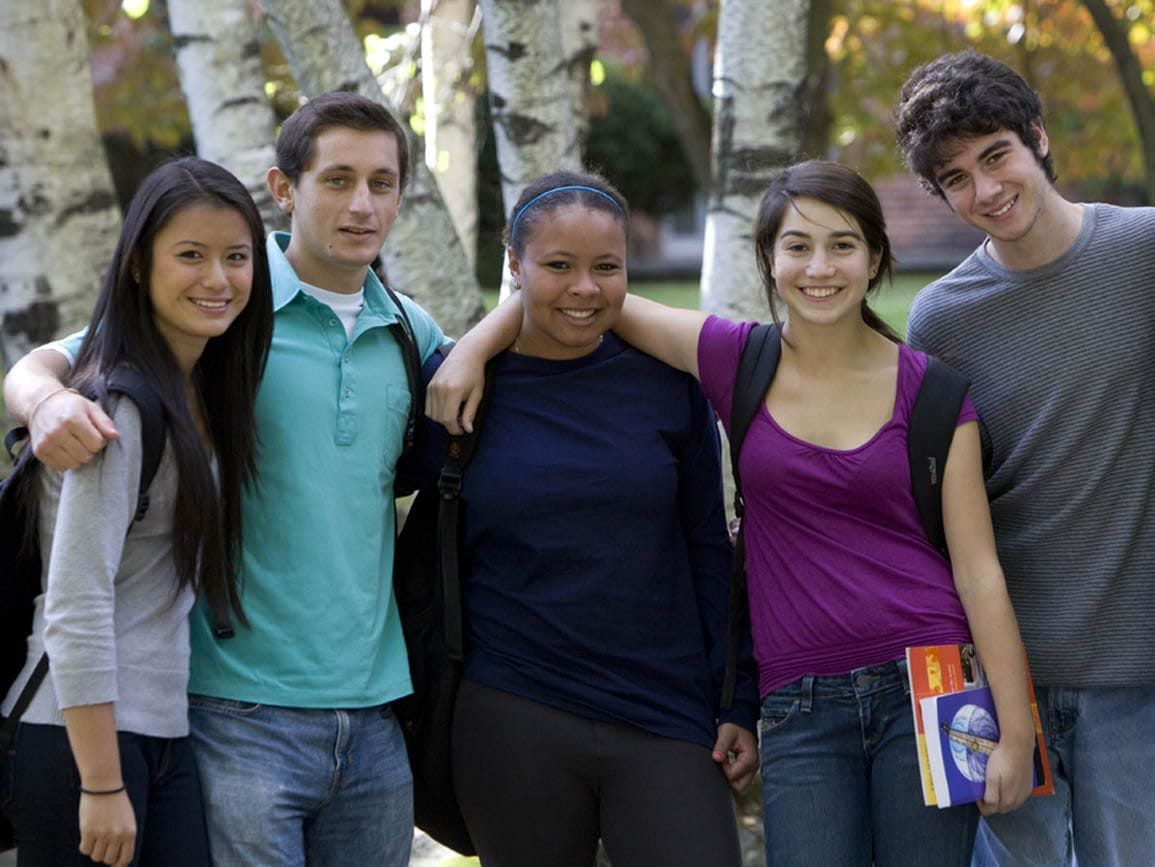 A group of teenagers posing together