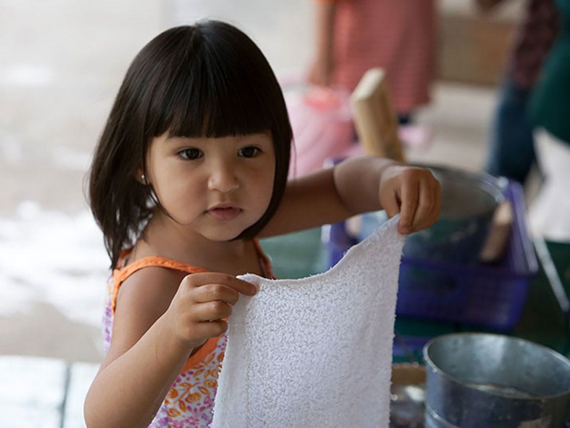 Preschool aged girl holding a wash cloth