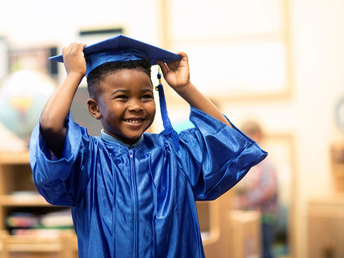 Kindergarten graduate in cap and gown