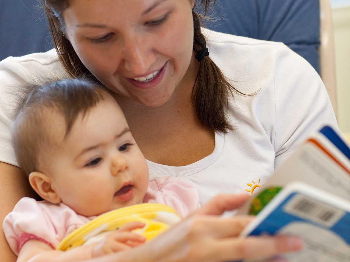 Teacher reading to an infant