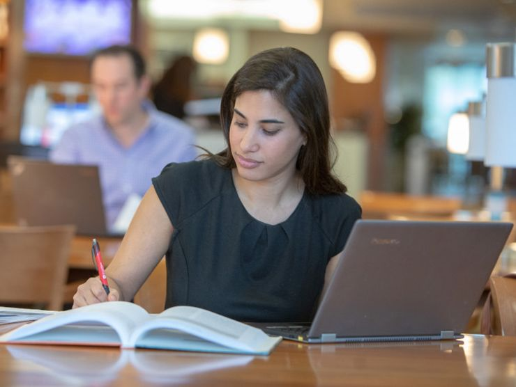 Young professional woman taking an online undergraduate course