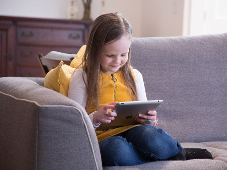 little girl looking at tablet
