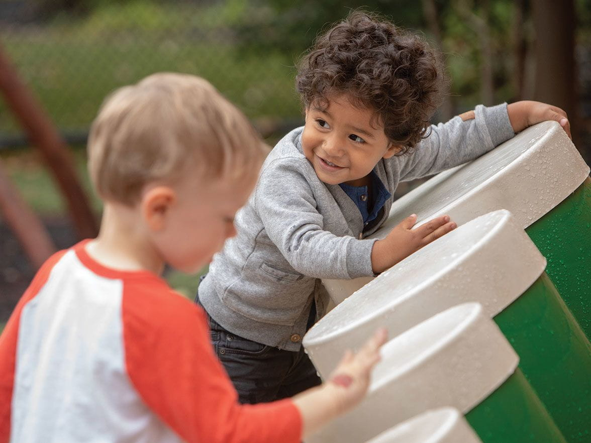 Outdoor playing and learning at Bright Horizons child care