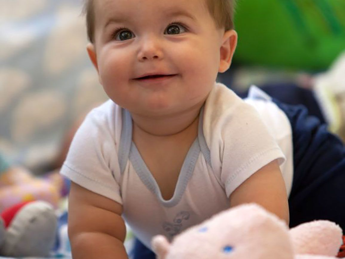 Baby smiling at toys