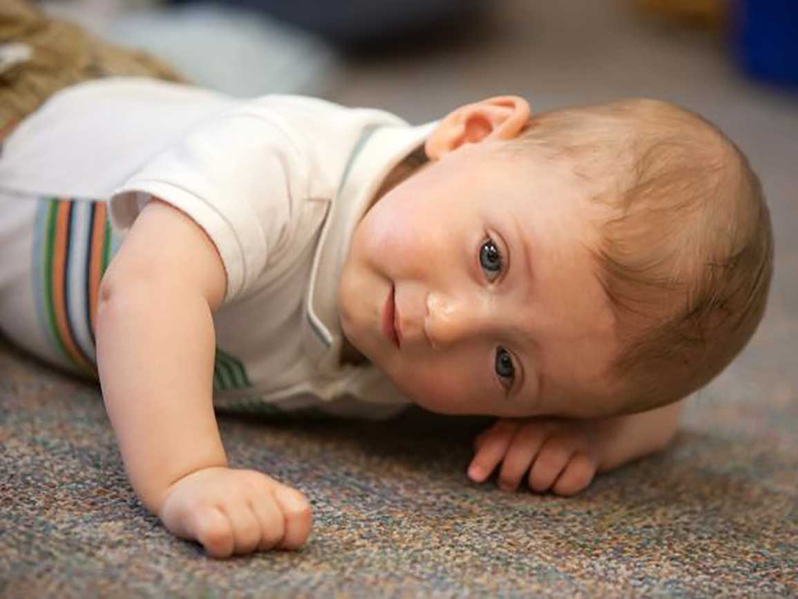 Baby crawling on a rug