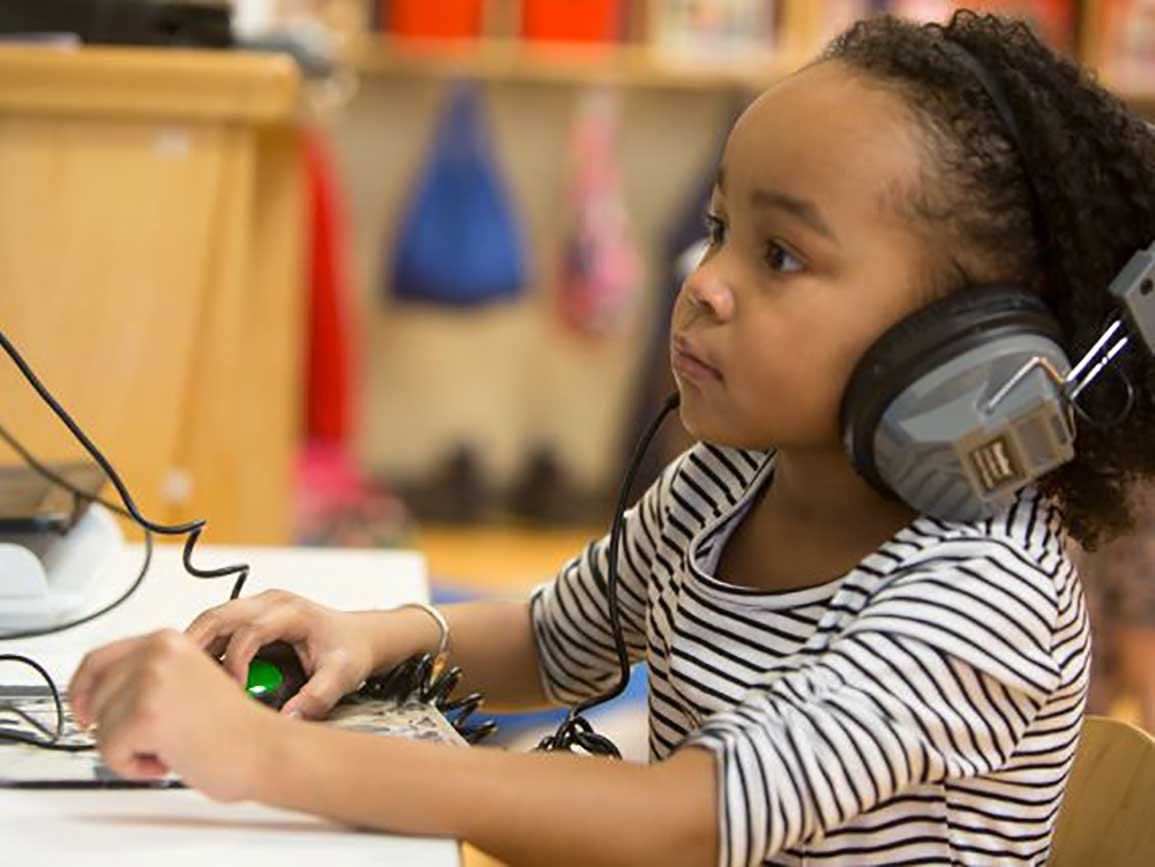 Preschool girl with headphones