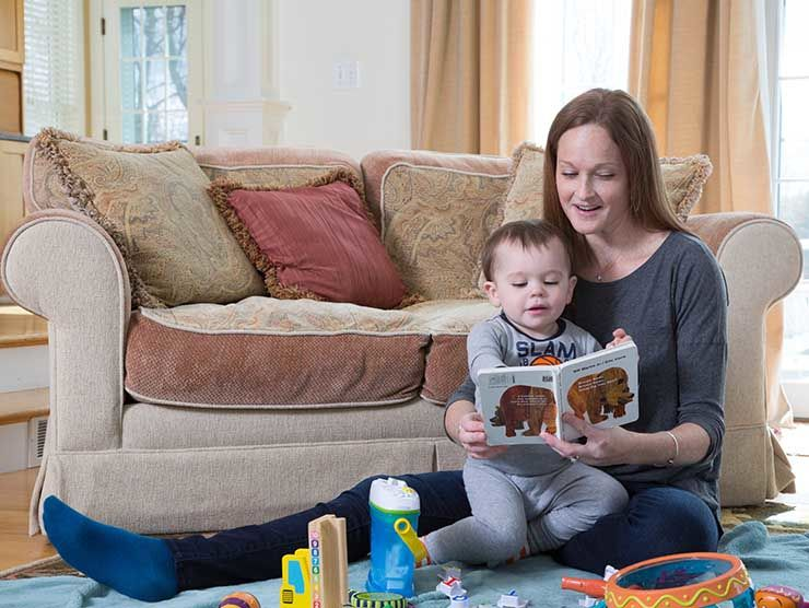 In-home back-up care provider reading to child