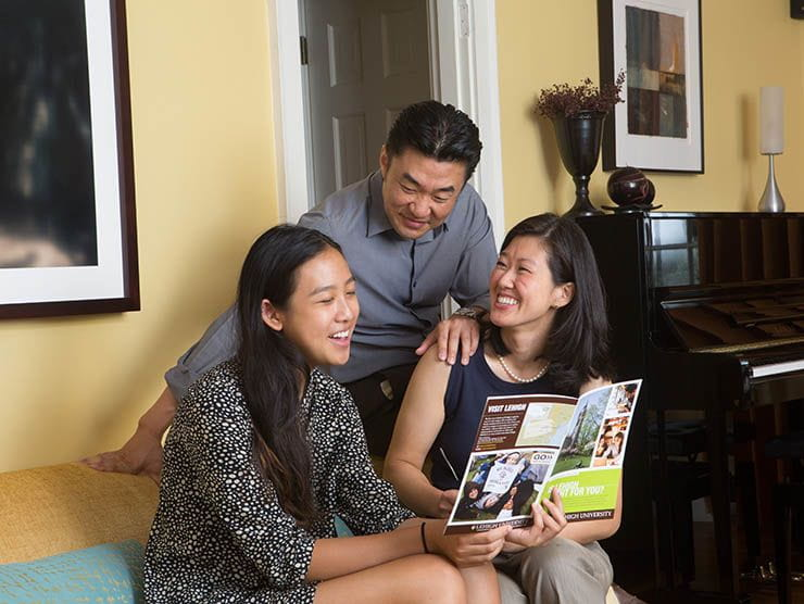 Family looking at college brochure