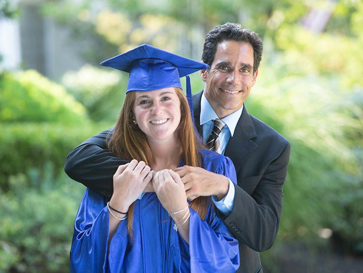 Female graduate with father