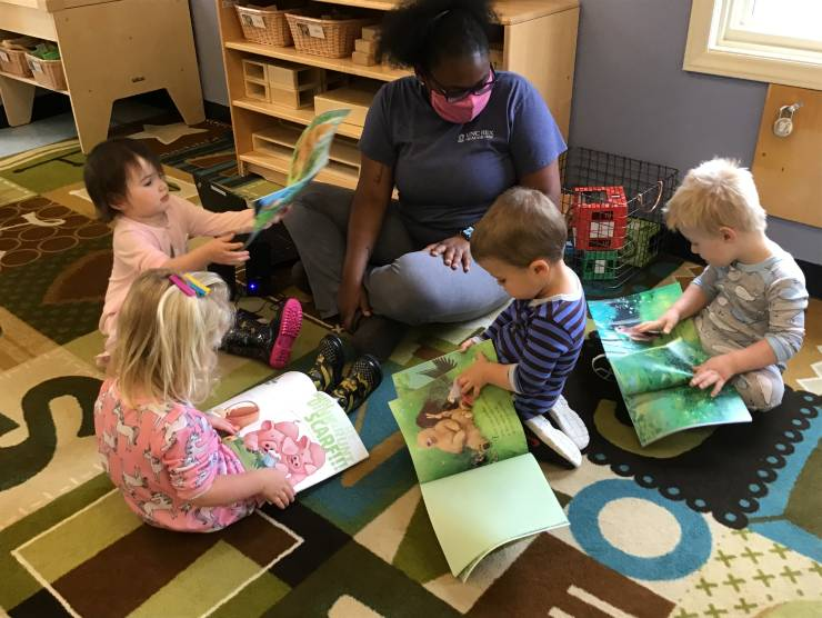 children and teacher reading
