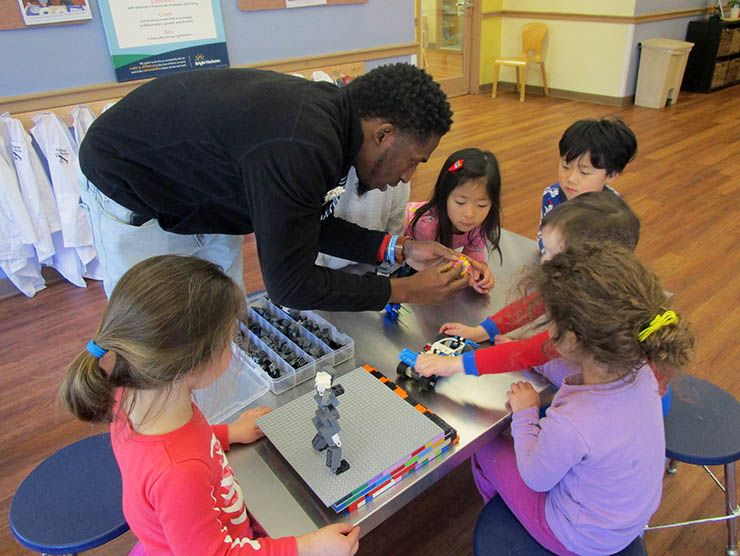 Travis Samuels leading  STEM lesson with LEGOs